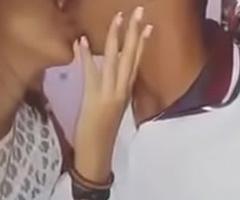 Indian boy giving a kiss his girlfriend